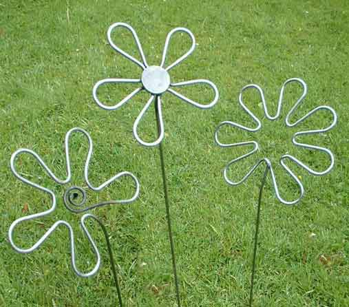 Handforged set of three lacquered flowers by Iron V ein designer makers